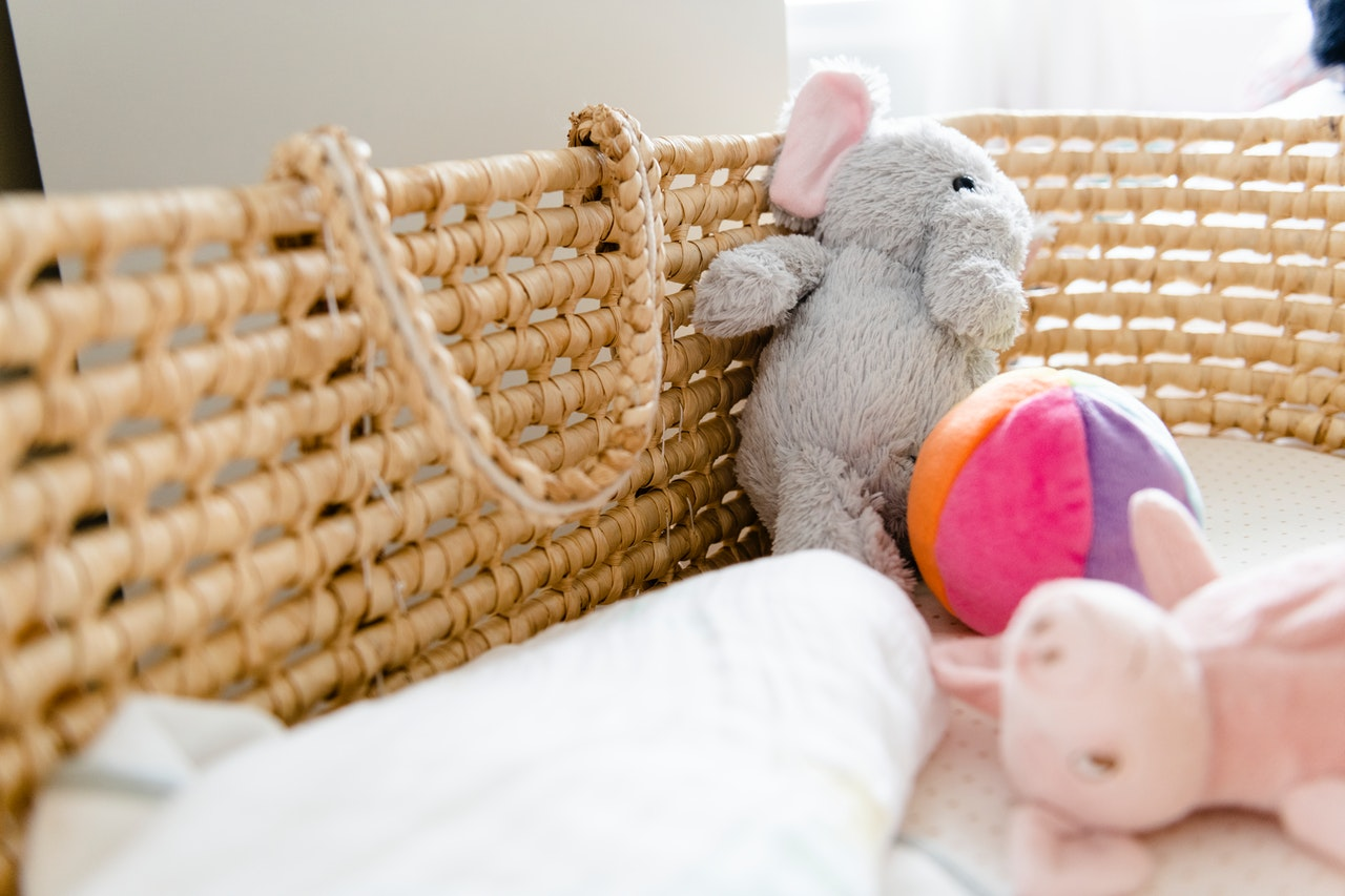baby basket with plush toys